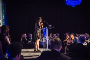 Shappi Khorsandi entertaining guests in the Banqueting Hall during an Awards Dinner at Glaziers Hall